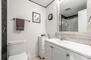 Photo 15: 105 Heritage Drive: Okotoks Mobile for sale : MLS®# A1133143