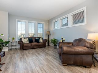 Photo 2: 193 River Heights Drive: Cochrane Row/Townhouse for sale : MLS®# A1083109