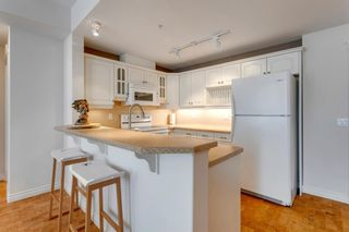 Photo 12: 304 2121 98 Avenue SW in Calgary: Palliser Apartment for sale : MLS®# A1093378