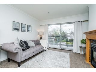 Photo 2: 211 20881 56 Avenue in Langley: Langley City Condo for sale : MLS®# R2553025
