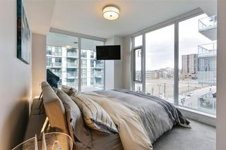 Photo 14: 405 519 Riverfront Avenue SE in Calgary: Downtown East Village Apartment for sale : MLS®# A1081632
