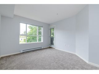 """Photo 9: 209 5465 203 Street in Langley: Langley City Condo for sale in """"Station 54"""" : MLS®# R2394003"""