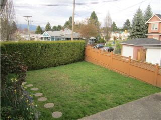 Photo 10: 2660 E 29TH Avenue in Vancouver: Collingwood VE House for sale (Vancouver East)  : MLS®# V1100437