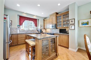Photo 11: 36 Versailles Gate SW in Calgary: Garrison Woods Row/Townhouse for sale : MLS®# A1098876