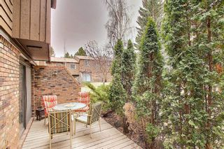 Photo 2: 14 287 Southampton Drive SW in Calgary: Southwood Row/Townhouse for sale : MLS®# A1100013