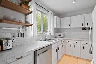 Photo 5: 103 120 Silvercreek Close NW in Calgary: Silver Springs Row/Townhouse for sale : MLS®# A1129249