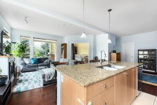 """Photo 3: 203 290 FRANCIS Way in New Westminster: Fraserview NW Condo for sale in """"Victoria Hill"""" : MLS®# R2617822"""