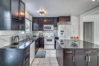 Photo 7: 10011 Warren Road SE in Calgary: Willow Park Detached for sale : MLS®# A1083323