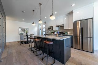 Photo 3: 105 1632 20 Avenue NW in Calgary: Capitol Hill Row/Townhouse for sale : MLS®# A1068096