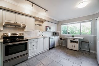 """Photo 3: 111 303 CUMBERLAND Street in New Westminster: Sapperton Townhouse for sale in """"Cumberland Court"""" : MLS®# R2606007"""