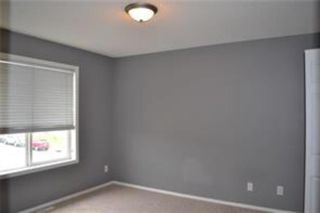 Photo 9: 92 Panamount Drive NW in Calgary: Panorama Hills Row/Townhouse for sale : MLS®# A1122234