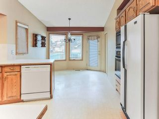 Photo 4: 51 SANDRINGHAM Way NW in Calgary: Sandstone Valley House for sale
