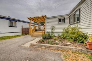 Photo 3: 59 9090 24 Street SE in Calgary: Riverbend Mobile for sale : MLS®# A1147460