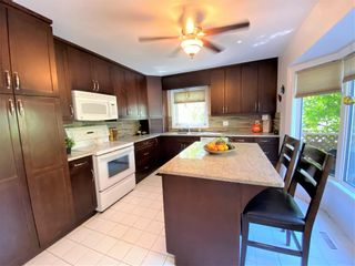 Photo 11: 518 Charleswood Road in Winnipeg: Charleswood Residential for sale (1G)  : MLS®# 202120289