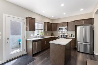 Photo 7:  in Calgary: Winston Heights/Mountview Row/Townhouse for sale : MLS®# A1105103