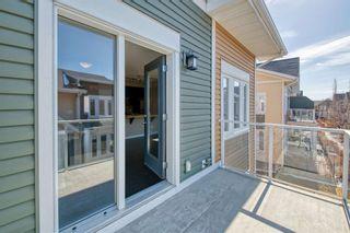 Photo 18: 818 Auburn Bay Square SE in Calgary: Auburn Bay Row/Townhouse for sale : MLS®# A1087965