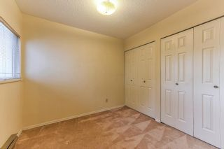 """Photo 14: 105 10091 156 Street in Surrey: Guildford Townhouse for sale in """"Guildford Park"""" (North Surrey)  : MLS®# R2321879"""
