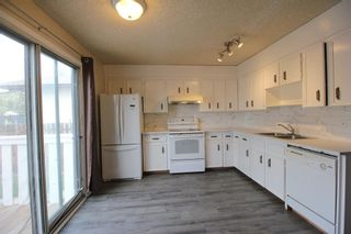 Photo 8: 38 EDGEDALE Court NW in Calgary: Edgemont Semi Detached for sale : MLS®# A1141906