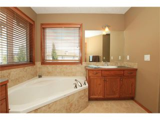 Photo 25: 18 WEST POINTE Manor: Cochrane House for sale : MLS®# C4072318