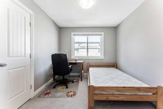 Photo 21: 702 69 Avenue SW in Calgary: Kingsland Semi Detached for sale : MLS®# A1081661