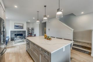 Photo 18: 98 23 Street NW in Calgary: West Hillhurst Row/Townhouse for sale : MLS®# A1066637
