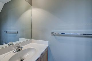 Photo 16: 312 BRIDLEWOOD Lane SW in Calgary: Bridlewood Row/Townhouse for sale : MLS®# A1046866
