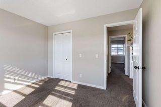 Photo 25: 60 Sunset Road: Cochrane Row/Townhouse for sale : MLS®# A1128537