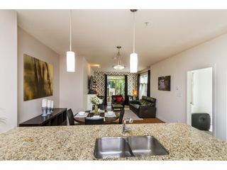 Photo 1: 101 101 MORRISSEY ROAD in Port Moody: Port Moody Centre Condo for sale : MLS®# R2113935