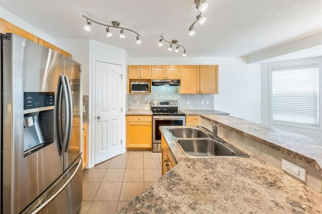 Photo 14: Photos: 53 Bridleridge Heights SW in Calgary: Bridlewood Detached for sale : MLS®# A1129360