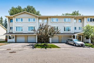 Main Photo: 704 Queenston Terrace SE in Calgary: Queensland Row/Townhouse for sale : MLS®# A1132508