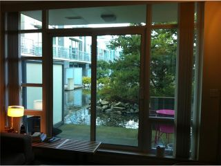 """Photo 1: 1463 W HASTINGS Street in Vancouver: Coal Harbour Townhouse for sale in """"WATERFRONT PLACE"""" (Vancouver West)  : MLS®# V1047188"""