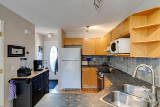 Photo 8: 418 Coral Cove NE in Calgary: Coral Springs Row/Townhouse for sale : MLS®# A1121739