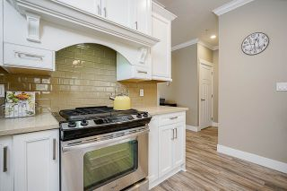 """Photo 13: 7793 211B Street in Langley: Willoughby Heights Condo for sale in """"SHAUGHNESSY MEWS"""" : MLS®# R2569575"""