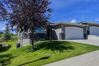 Photo 2: 7 ELYSIAN Crescent SW in Calgary: Springbank Hill Semi Detached for sale : MLS®# A1104538