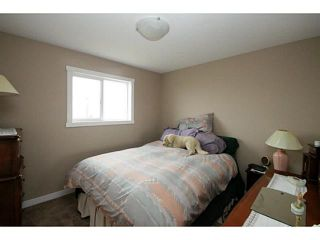 Photo 11: 245 RANCH RIDGE Meadows: Strathmore Townhouse for sale : MLS®# C3615774