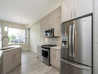 """Photo 3: 112 2120 GLADWIN Road in Abbotsford: Central Abbotsford Condo for sale in """"Onyx at Mahogany"""" : MLS®# R2617178"""