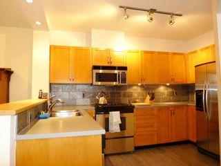 Photo 2: 309 2263 REDBUD Lane in TROPEZ: Home for sale : MLS®# V1025643