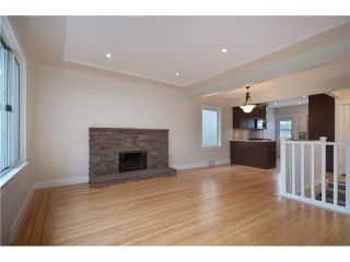 Photo 2: 4847 HENRY Street in Vancouver: Knight House for sale (Vancouver East)  : MLS®# V996847