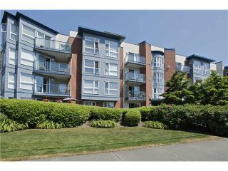 """Photo 1: 207 20277 53 Avenue in Langley: Langley City Condo for sale in """"Metro II"""" : MLS®# F1446990"""