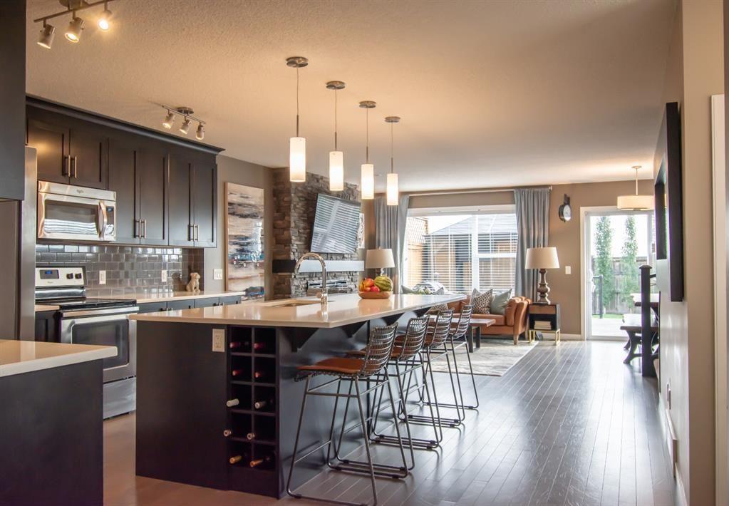 Photo 3: Photos: 281 AUBURN MEADOWS Place SE in Calgary: Auburn Bay Duplex for sale : MLS®# A1014528