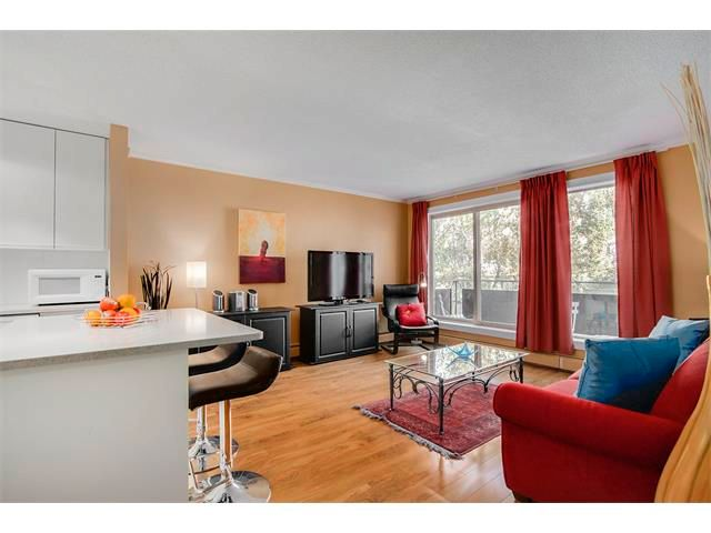 Spacious Living Room; high end laminate flooring, large windows with sliders to balcony.