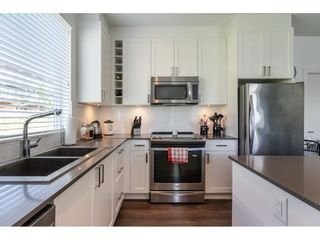 """Photo 7: 304 16396 64 Avenue in Surrey: Cloverdale BC Condo for sale in """"The Ridgse and Bose Farms"""" (Cloverdale)  : MLS®# R2579470"""