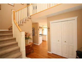 Photo 3: 51 GLENEAGLES View: Cochrane House for sale : MLS®# C4008842
