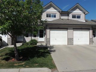 Photo 1: 37 MILLVIEW Green SW in Calgary: Millrise House for sale : MLS®# C4015611