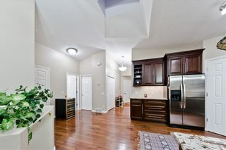 Photo 4: BRIDLEWOOD PL SW in Calgary: Bridlewood House for sale
