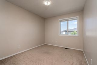 Photo 15: 122 Luxstone Road SW: Airdrie Detached for sale : MLS®# A1129612