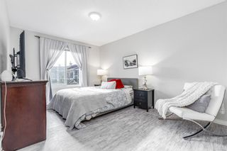 Photo 19: 85 Hidden Creek Rise NW in Calgary: Hidden Valley Row/Townhouse for sale : MLS®# A1104213