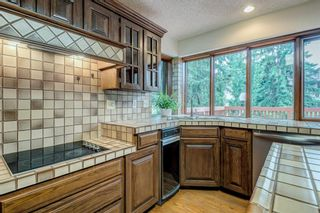 Photo 15: 331 Coach Light Bay SW in Calgary: Coach Hill Detached for sale : MLS®# A1132031