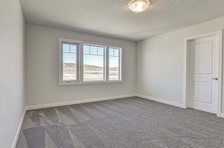 Photo 18: 132 Creekside Drive SW in Calgary: C-168 Semi Detached for sale : MLS®# A1144861