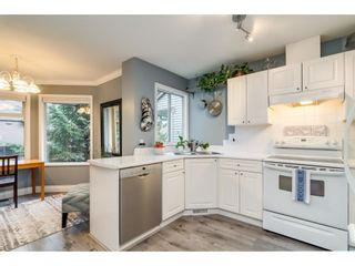 """Photo 6: 112 13900 HYLAND Road in Surrey: East Newton Townhouse for sale in """"Hyland Grove"""" : MLS®# R2336743"""